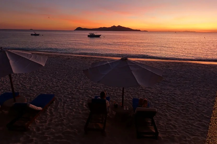 A beautiful sunset, as enjoyed from the beach bar.