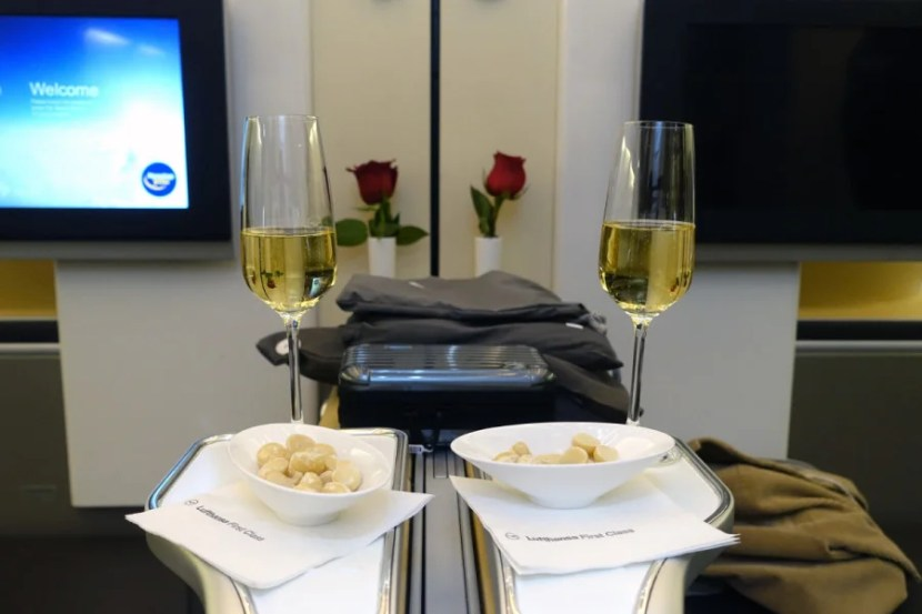 Champagne and amenity kits before departure.