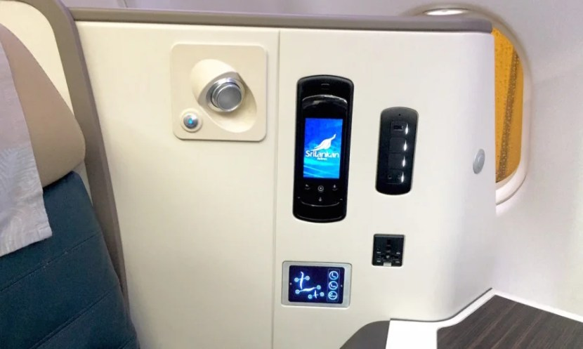 The power ports, seat controls and IFE handheld touchscreen control.