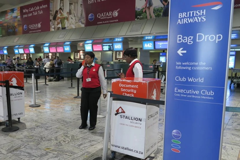 Contract security staff checked your documents before allowing you to approach the bag drop counter.