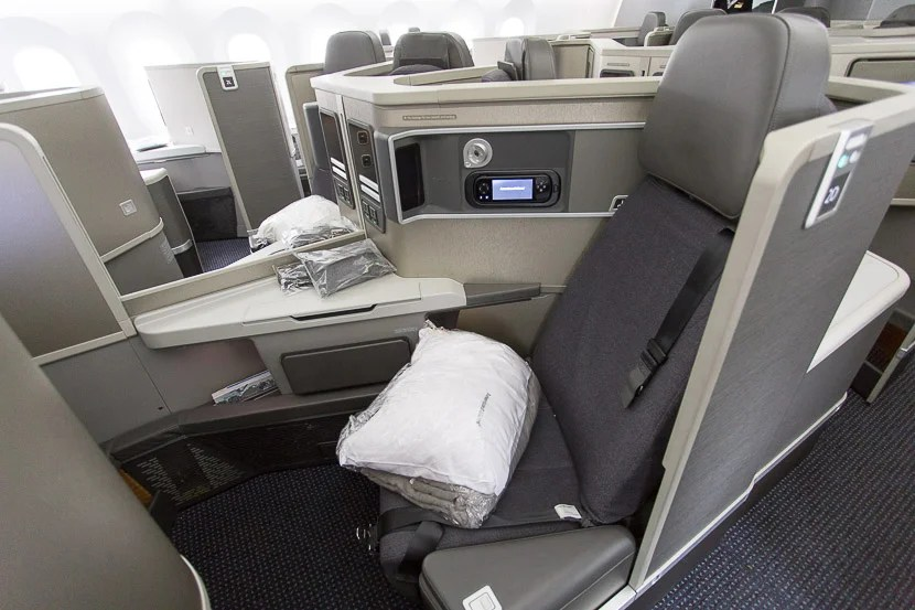 Forward-facing seats are open to the aisle and have a movable armrest on the aisle side.
