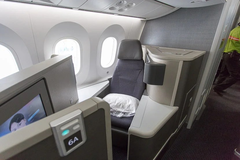 Backward-facing seats, such as 6A, have more personal space with two side tables, but are narrower without the side armrest.