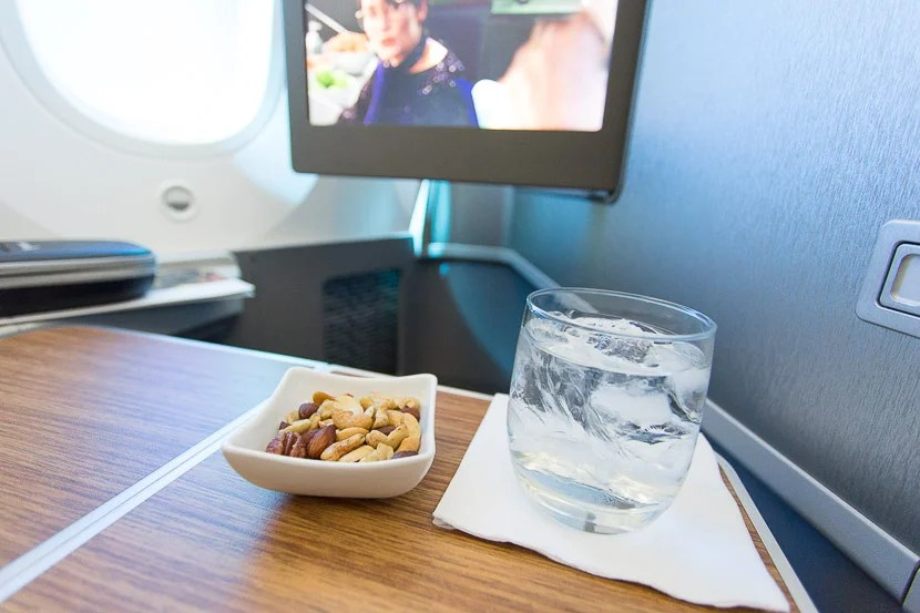 Hot towels, nuts and a drink are distributed shortly after takeoff.