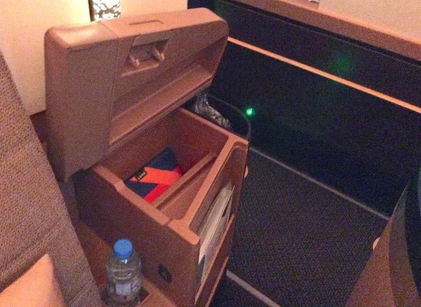 The storage cubby inside the wide armrest.