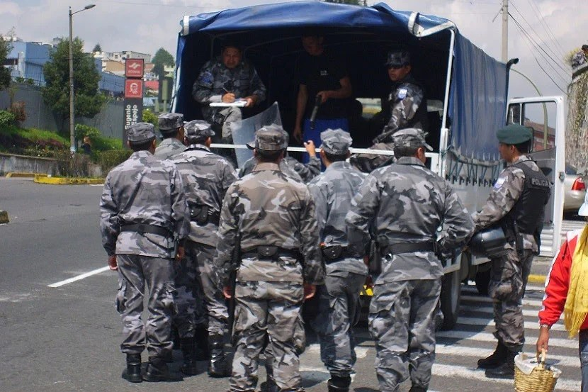 Alone or not, in retrospect it probably wasn't a great idea to take photos of heavily armed Ecuadorian police preparing to deal with protesters.