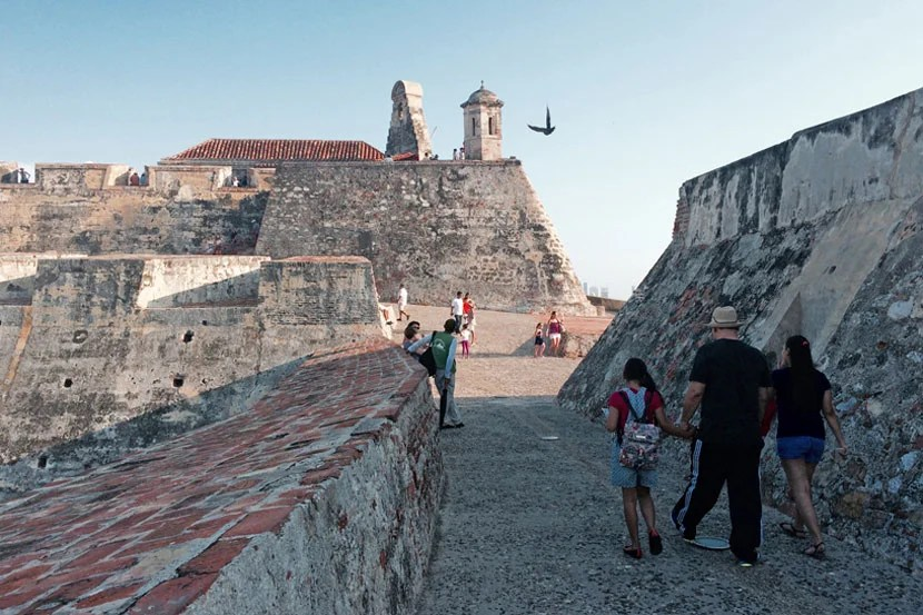 A modern-day family strolling the walls of Spanish-Colonial Cartagena's imposing fort, the Castillo San Felipe de Barajas.