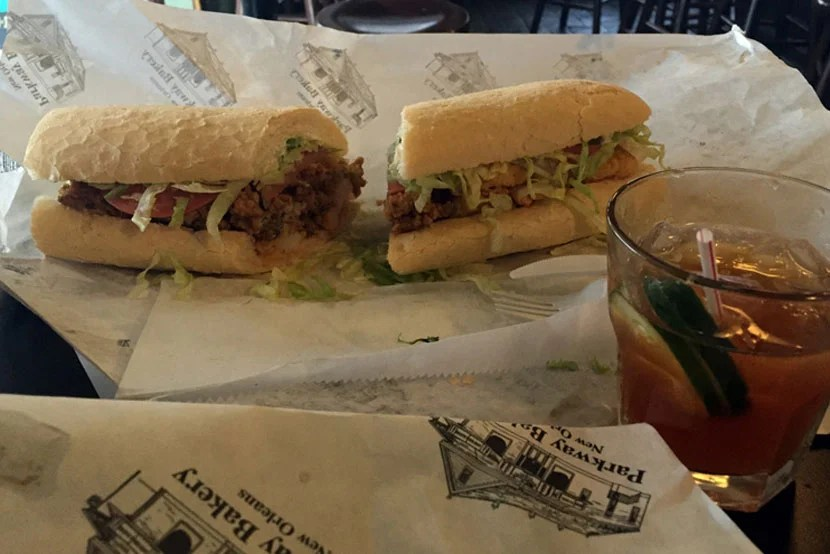 Po'boy, half fried oyster, half fried Gulf shrimp, and a Pimm's Cup, at Parkway Bakery and Tavern.