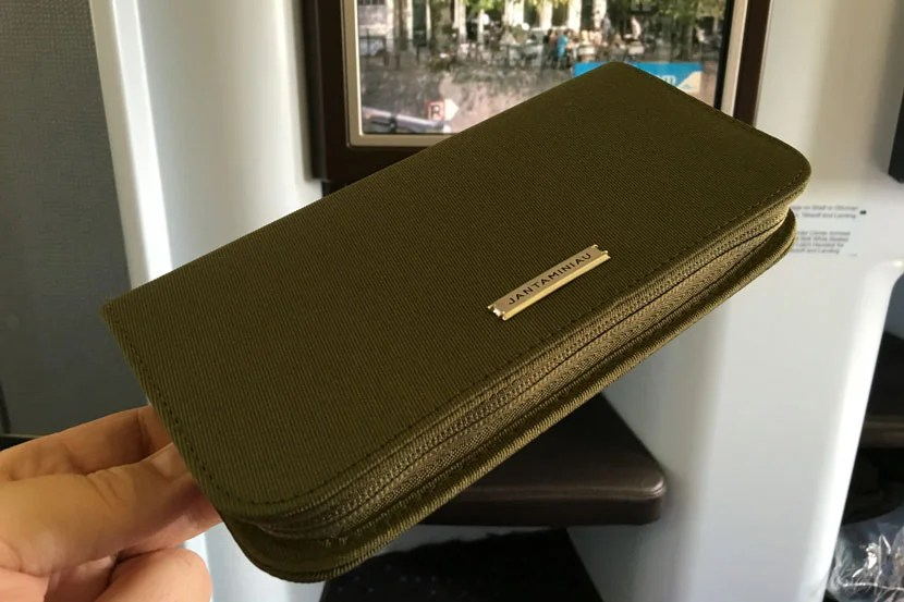 The new KLM amenity kit (green for the gents' version) is reusable as a travel wallet, but a little lacking in goodies on the inside.