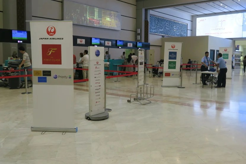 Oneworld Sapphires can use the First Class check-in at CGK.