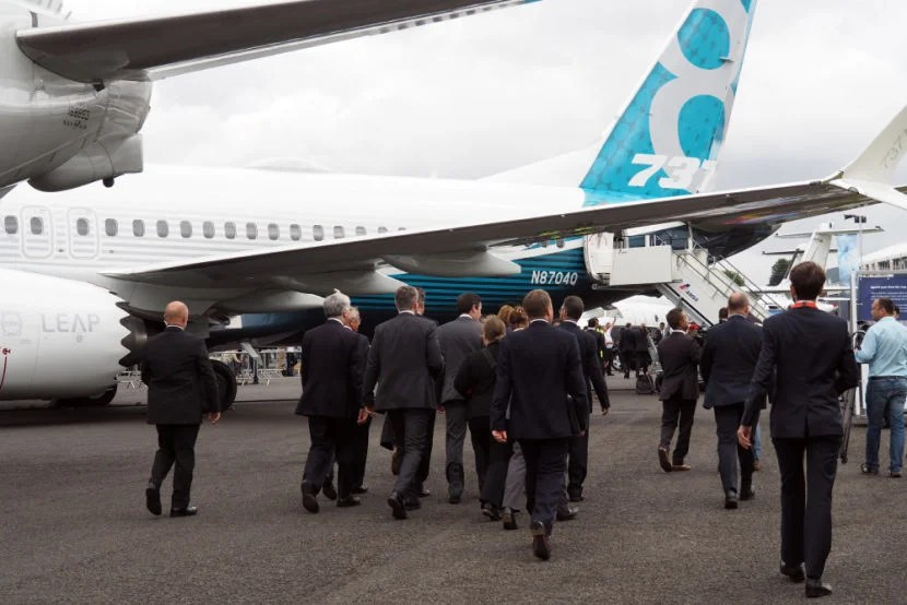 The British PM's entourage passes by the 737 MAX following a visit to the Boeing booth.