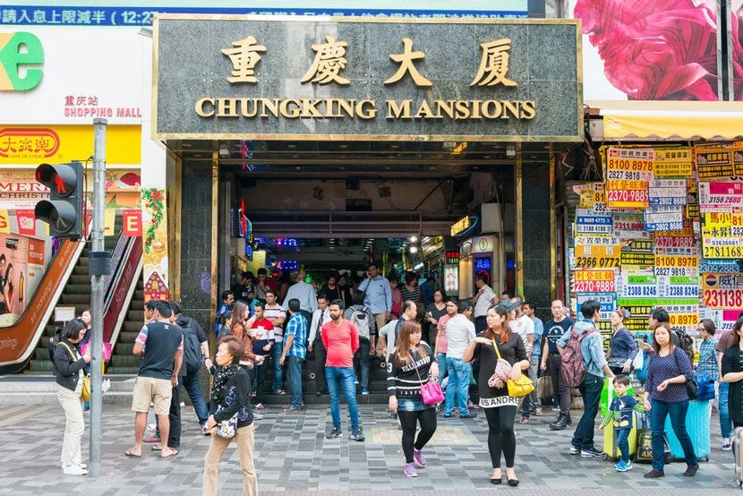 """On the outside, it's just another building. On the inside, it's a whole otherworld. Image courtesy of <a href=""""http://www.shutterstock.com/pic-399525055/stock-photo-hong-kong-nov-30-2015-chungking-mansions-a-famous-tourist-spot-in-tsim-sha-tsui-kowloon-hong-kong.html?src=Zc4QMyklVHBueYxJMr9cbA-1-0"""" target=""""_blank"""">Shutterstock</a>."""