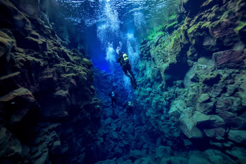 """Snorkel the Silfra fissure, just one hour from Reykjavik. Photo courtesy of <a href=""""http://www.shutterstock.com/pic-299902592/stock-photo-silfra-iceland.html?src=tI62Rfkptw3IdE4vj0NFLQ-1-14"""">Shutterstock</a>."""