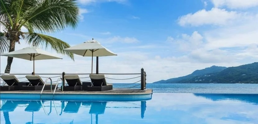 Enjoy the picture-perfect view from the infinity pool at Le Meridien Fisherman's Cove in the Seychelles.
