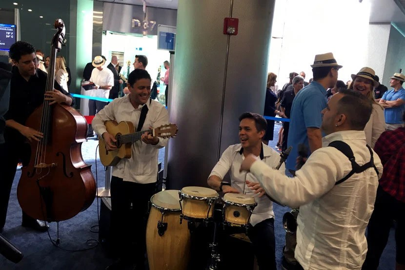 As part of the inaugural flight celebration, a band played Cuban music at the gate.