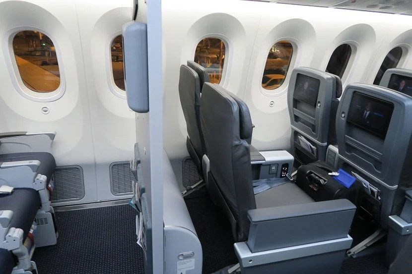 There's a thin wall between economy and premium economy cabins.