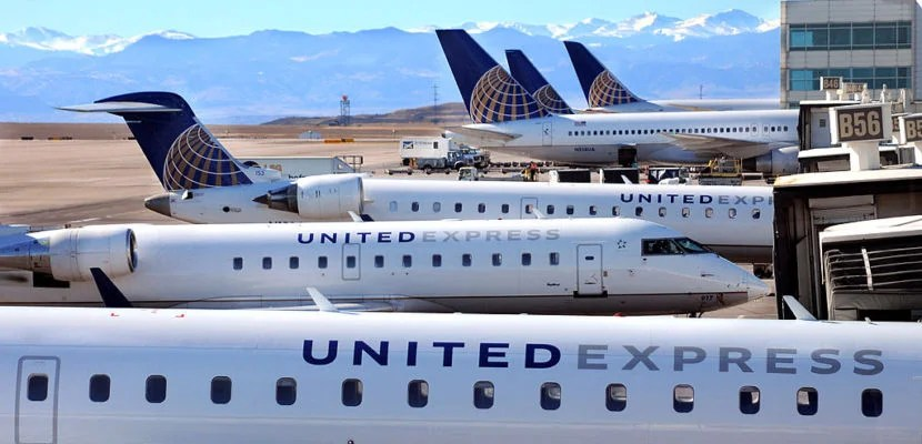 DENVER, CO - JANUARY 19, 2014: United Express and United Airlines passenger jets are lined up at the gates at Denver International Airport in Denver, Colorado. (Photo by Robert Alexander/Getty Images)