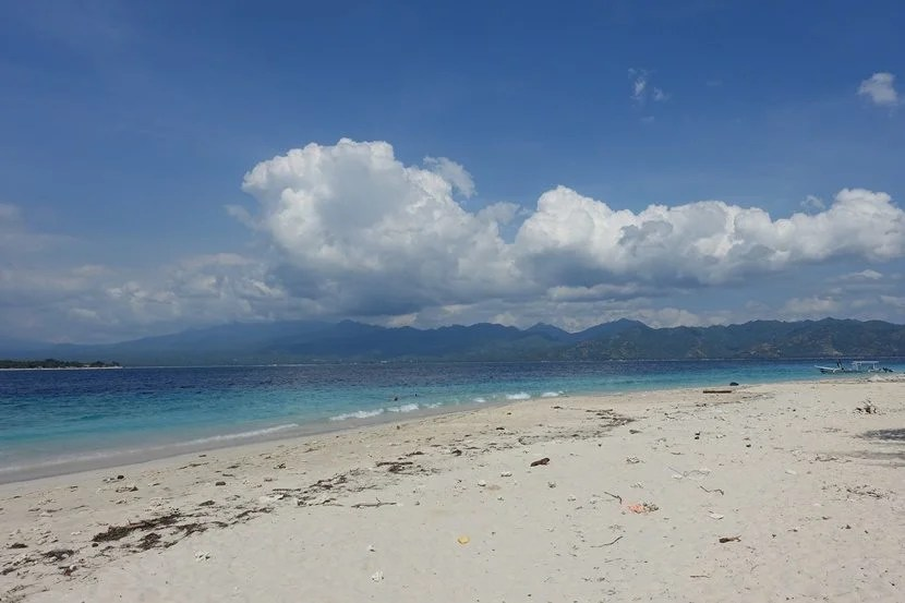 A deserted beach on Gili Meno with views of Lombok. Photo by Lori Zaino.