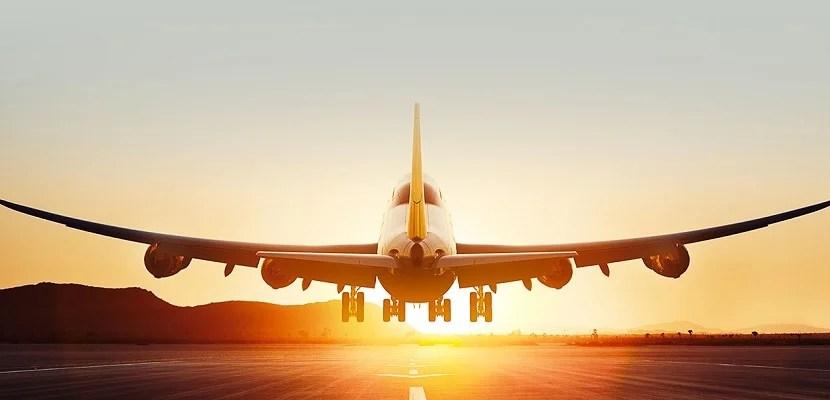IMG Plane jet landing sunset featured