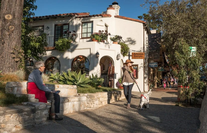 "City-dwellers love to escape to the picturesque town of Carmel. Image courtesy of <a href=""http://www.shutterstock.com/pic-344715023/stock-photo-carmel-by-the-sea-california-united-states-november-28-2015-a-fashionably-dressed-tall-and-slender-woman-strolls-down-a-sidewalk-in-carmel-on-a-november-afternoon.html?src=ulZXq4TrSkZiZufelE3Gnw-1-1"">Shutterstock</a>."