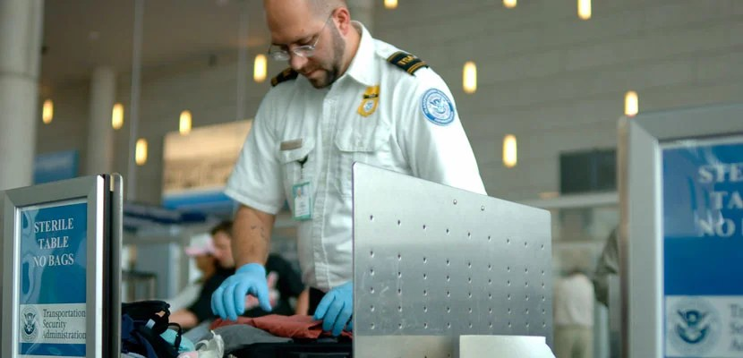 TSA agent at the airport. Image courtesy of Shutterstock.