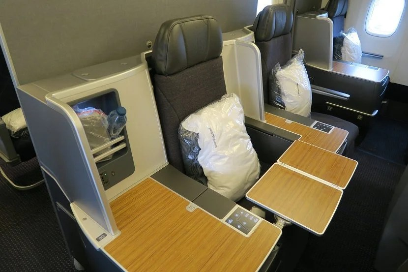 The rear middle seats shown with tray table extended.