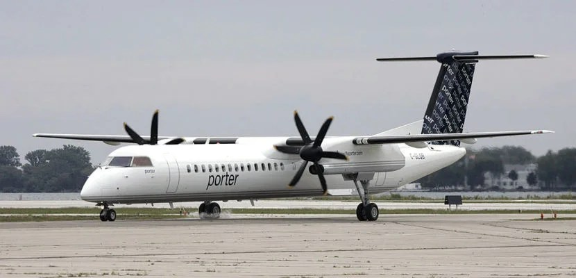 The first Porter Airlines plane taxis to the ramp at the City Centre Airport in Toronto, Tuesday Aug. 29, 2006. The 70 passenger Bombardier Q400 is the first of ten planes the company has ordered. (Photo by David Cooper/Toronto Star via Getty Images)