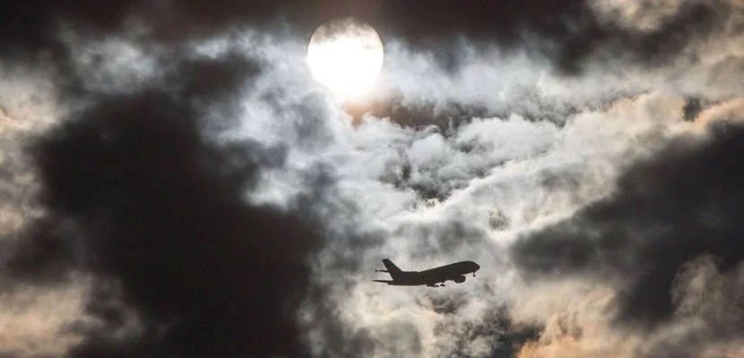 A plane flies through the morning sky past the sun hidden behind clouds on February 11, 2016 in Frankfurt am Main, western Germany.  / AFP / dpa / Frank Rumpenhorst / Germany OUT        (Photo credit should read FRANK RUMPENHORST/AFP/Getty Images)