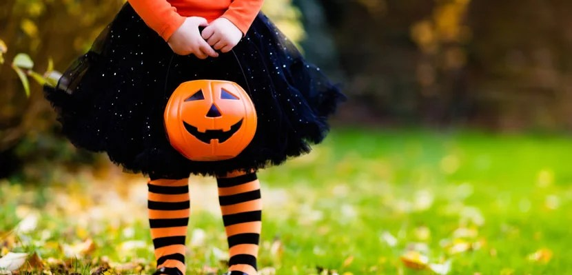 Little girl trick-or-treating on Halloween. Image courtesy of Shutterstock.