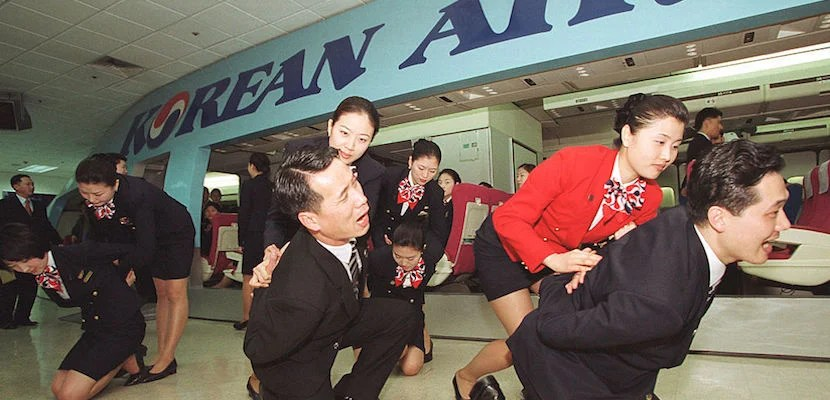 A Korean Air flight crew demonstrates a mock anti-terrorist drill at a training institute March 21, 2002 in Seoul. Korean Air announced March 21, 2002 that it planned to conduct an eight hour long self-defense training course for about 4,000 flight crews before the upcoming Federation Internationale de Football Association (FIFA) World Cup to ensure flight security. Image courtesy of Chung Sung-Jun/Getty Images.
