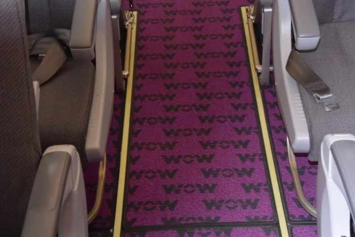Company branding is everywhere on a WOW flight, including on the custom carpets.