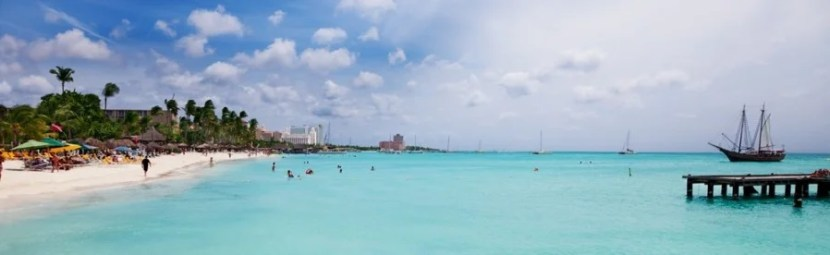 You can visit Aruba and other islands in the Dutch Caribbean for just 25,000 miles round-trip from the US.