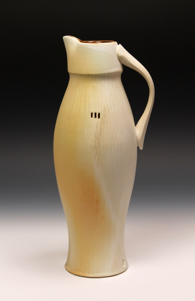 Nick DeVries satin orange pitcher