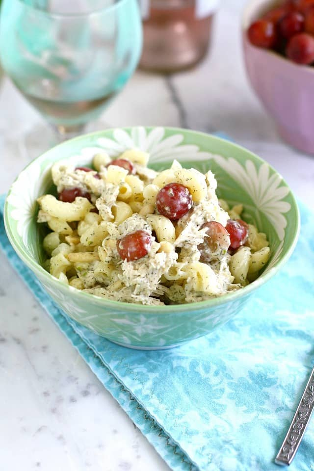 A chicken pasta salad recipe with dilled avocado sauce and grapes.