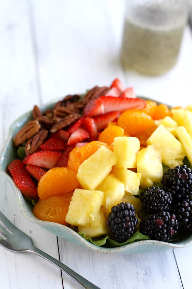 A rainbow salad filled with fresh fruit and topped with poppyseed dressing. Vegan and gluten free. #vegan #glutenfree