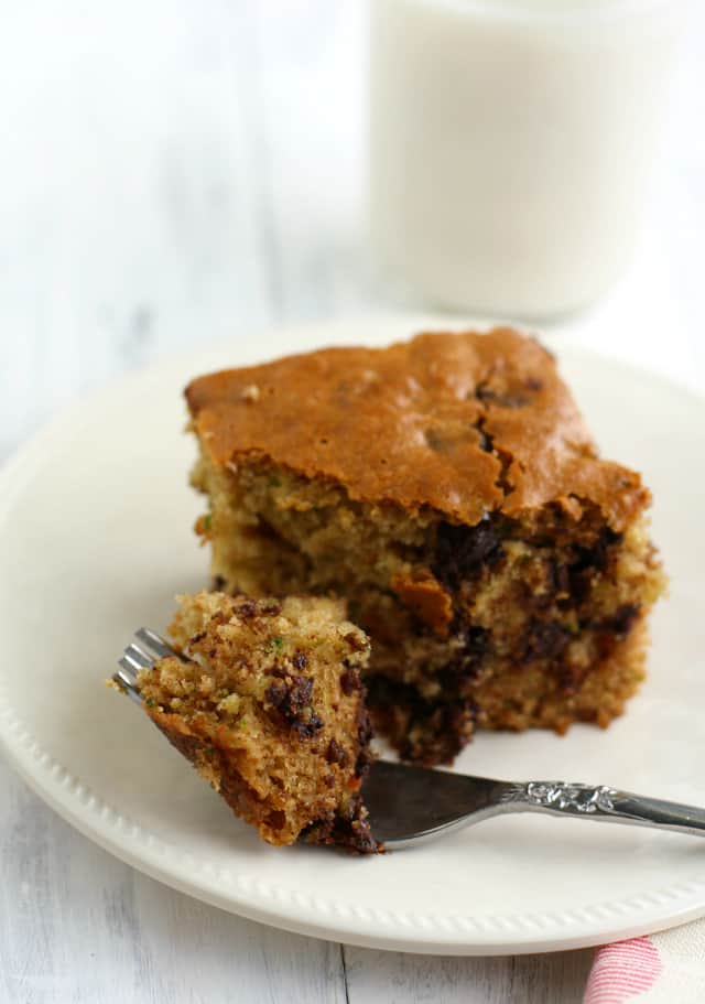 Light and fluffy zucchini cake made with chocolate chips. This cake is delicious and vegan!