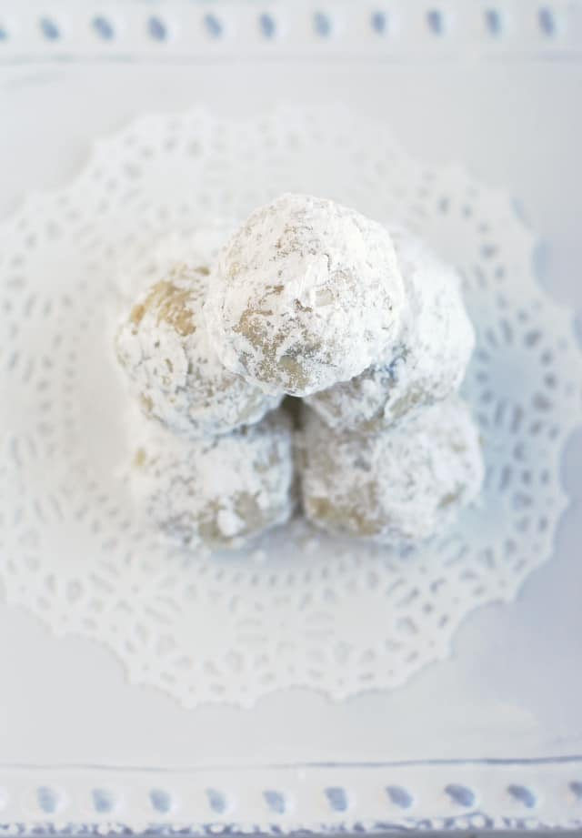 Snowball cookies - so easy to make, and so delicious! Little bites of shortbread covered in powdered sugar - heaven!