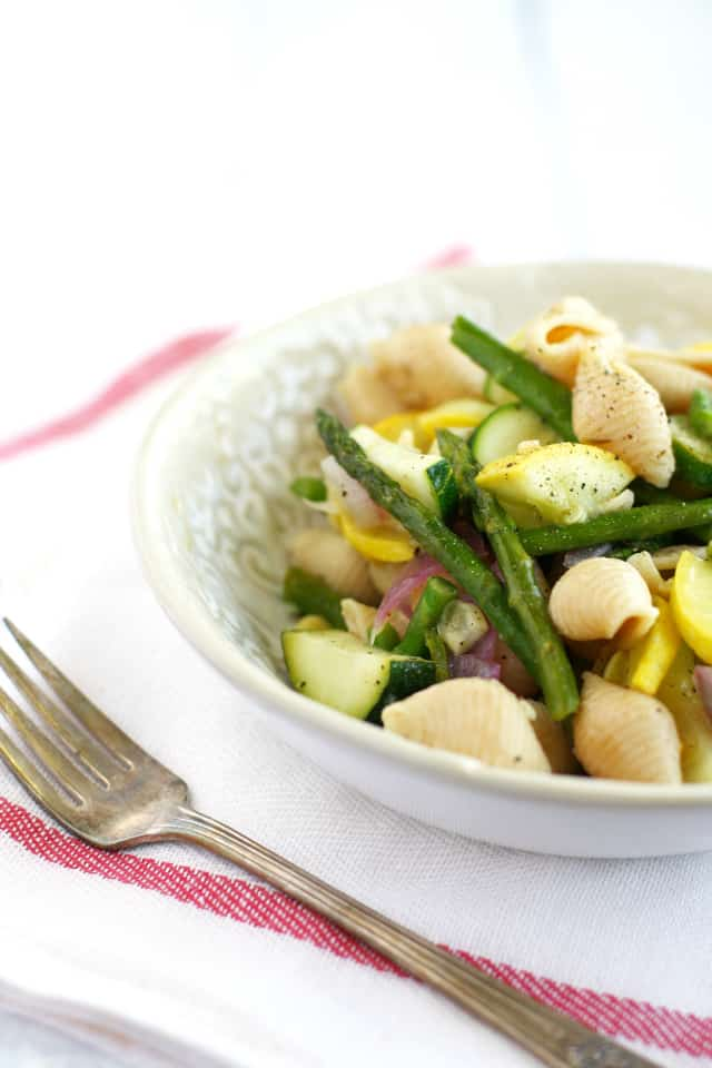 Light and healthy pasta with spring vegetables and a flavorful lemon garlic sauce. #healthy