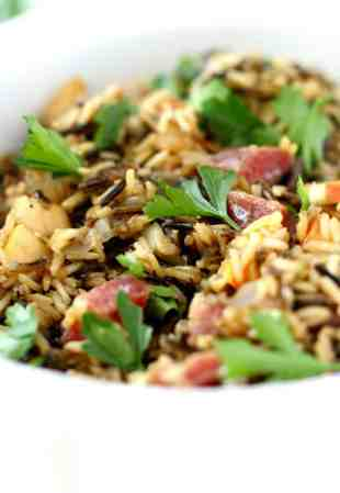 A delicious addition to the Thanksgiving table...gluten free wild rice stuffing with mushrooms, onions, apples, and salami. #glutenfree #shop AD