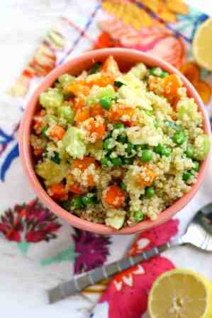 An easy quinoa salad that's perfect for a picnic! It's loaded with veggies and a delicious mustard vinaigrette. Vegan and gluten free.