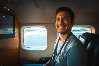 molokai travel, Hapa man smiling on airplane