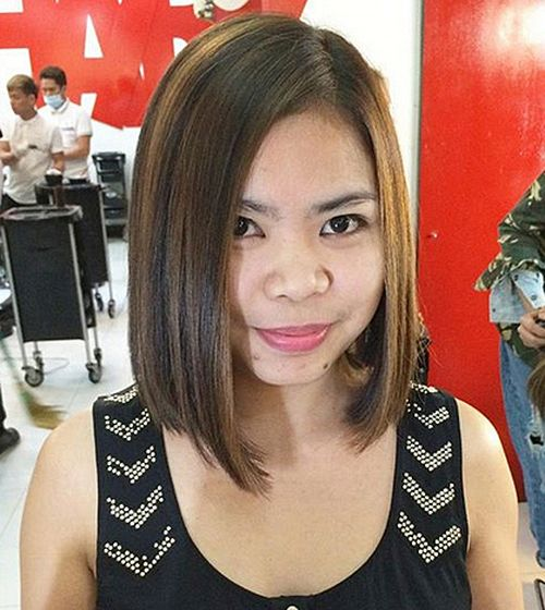 dark brown asymmetrical bob with highlights