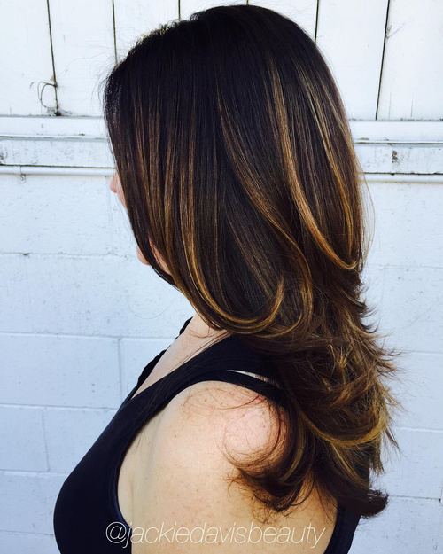 long dark brown hairstyle with honey highlights