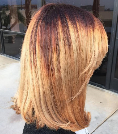 Medium Strawberry Blonde Hairstyle With Bangs