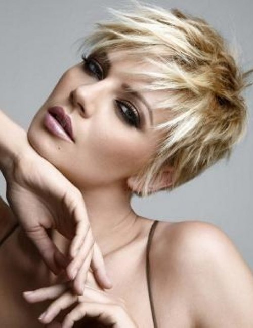 Short haircut pixie with a loose structure