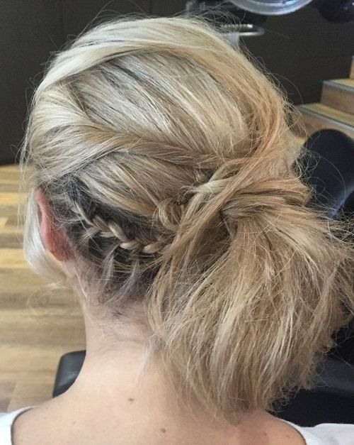 messy side pony with braids and twists