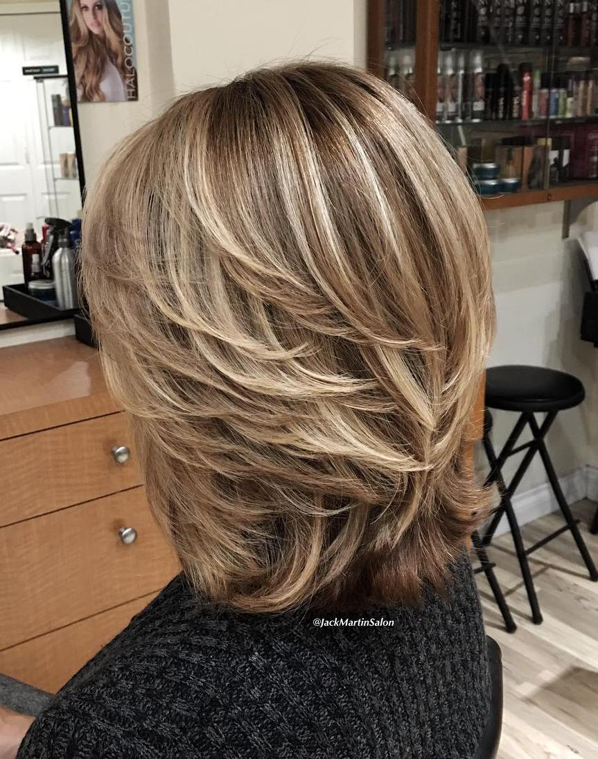 Curly blonde hair back