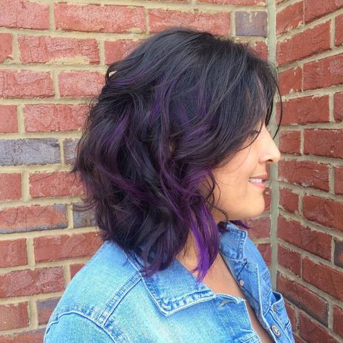 medium length black hairstyle with purple highlights