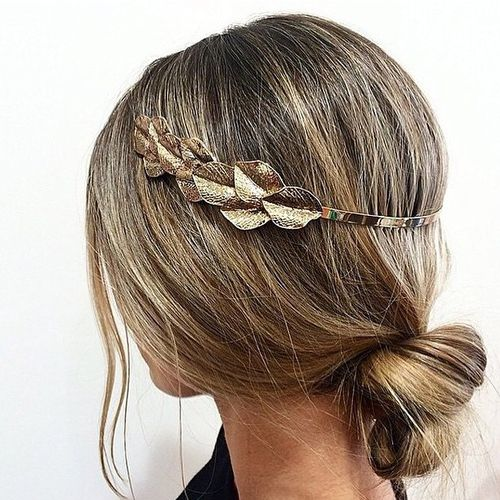 loose low knot hairstyle with a headband