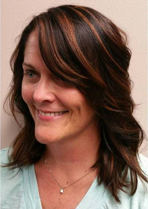 medium layered haircut with long side bangs
