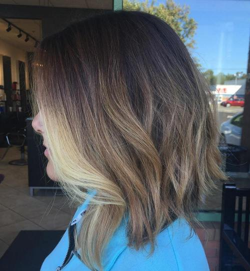 dark brown lob with light brown and blonde ombre highlights